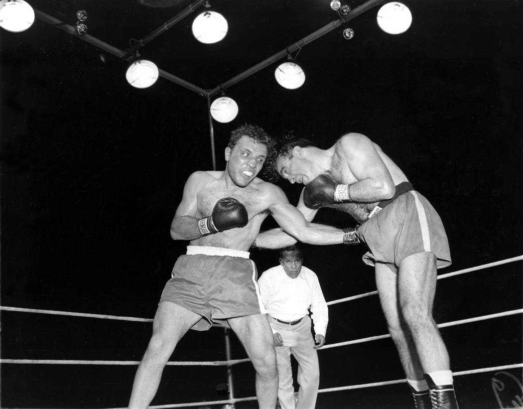 Jake LaMotta, left, pounds Marcel Cerdan in third round of a world middleweight title bout in Detroit, June 16, 1949. LaMotta won the title by a knockout in the 10th round. LaMotta died Tuesday, S ...