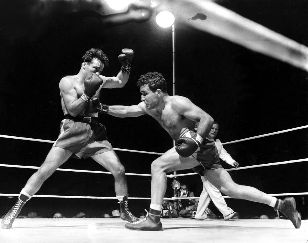 Jake LaMotta, right, fighting Marcel Cerdan in Briggs Stadium in Detroit, June 16, 1949. LaMotta knocked out Cerdan in the 10th round to become the new world middleweight champion. LaMotta died Tu ...