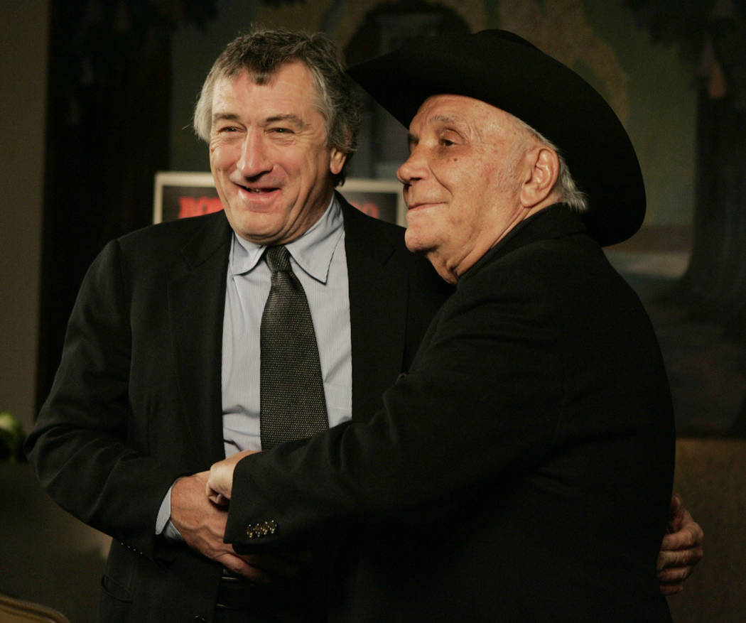 "Robert DeNiro, left, and boxer Jake LaMotta stand for photographers before watching a 25th anniversary screening of the movie ""Raging Bull"" in New York, Jan. 27, 2005. LaMotta, whose life was depi ..."