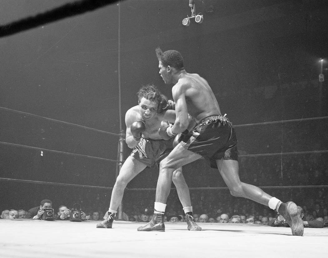 Jake LaMotta, left, of the Bronx borough of New York, and Ray Robinson of the Harlem section of New York, fight at Madison Square Garden in New York, Feb. 23, 1945. LaMotta, whose life was depicte ...