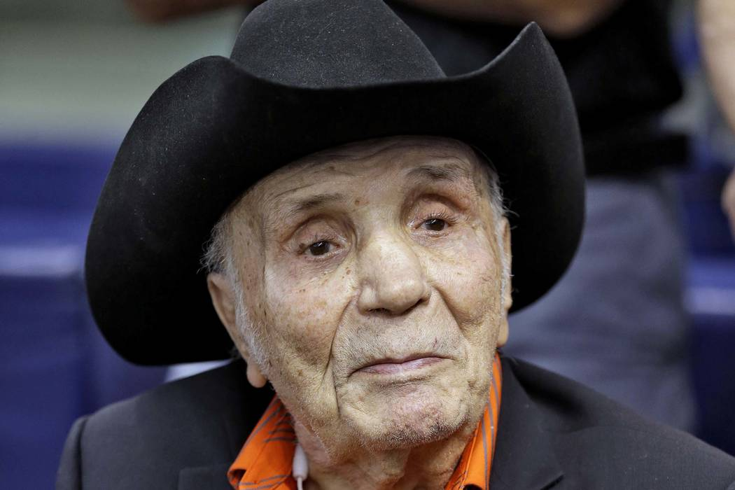 Jake LaMotta watches batting practice before a baseball game between the Tampa Bay Rays and the New York Yankees in St. Petersburg, Fla., Sept. 15, 2015. LaMotta, whose life was depicted in the fi ...