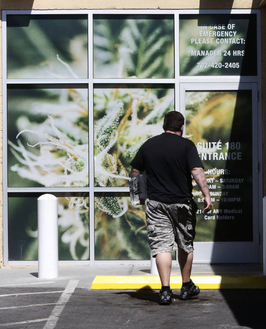A customer enters Oasis Cannabis Dispensary at 1800 S. Industrial Rd. on Wednesday, Sept. 20, 2017, in Las Vegas. Oasis Cannabis is primed to be the first 24/7 marijuana dispensary located near th ...
