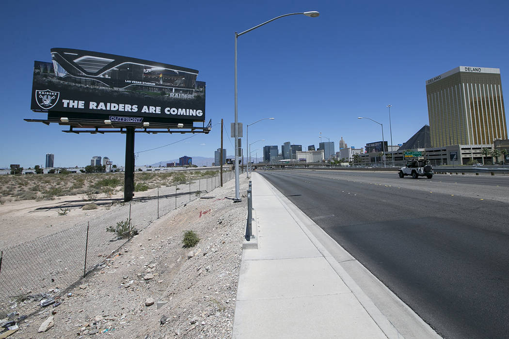 A billboard advertising the Raiders at the proposed stadium site near Russell Road and Dean Martin Drive on Sunday, May 28, 2017. Richard Brian Las Vegas Review-Journal @vegasphotograph