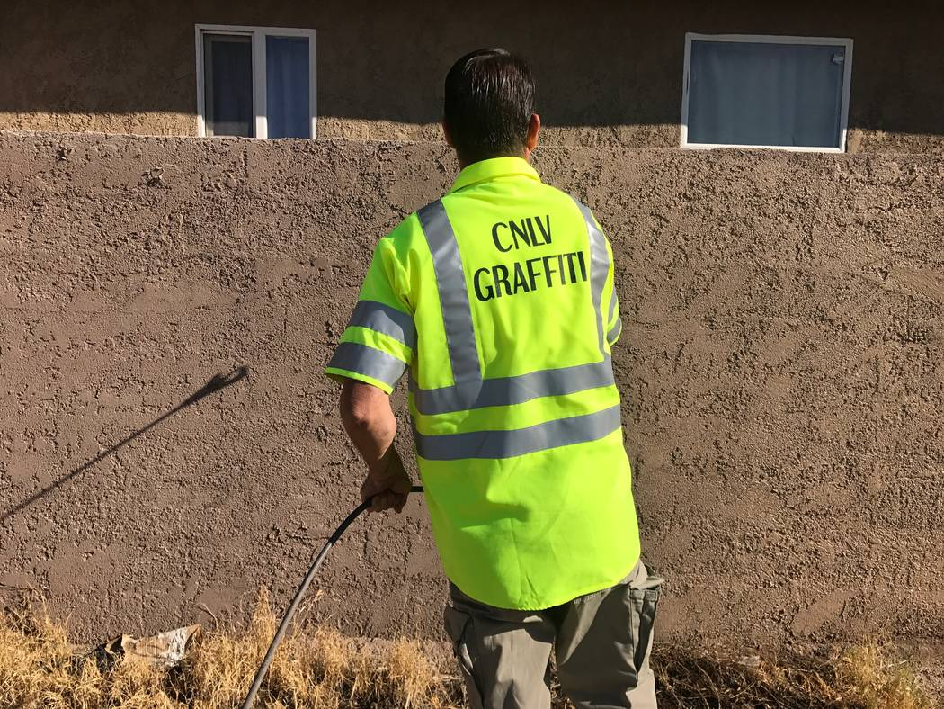 Tim Schmidt paints a wall that was been vandalized on Thursday, Aug. 14, 2017 in North Las Vegas. (Kailyn Brown/View) @KailynHype