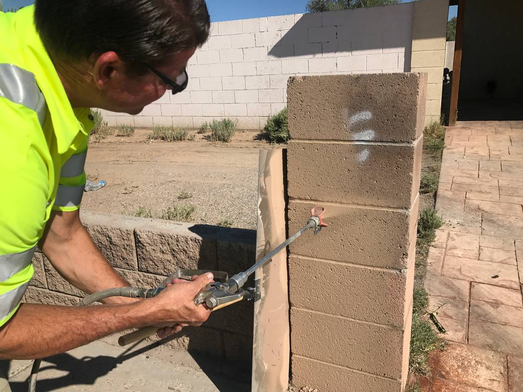 Tim Schmidt paints a structure that was been vandalized on Thursday, Aug. 14, 2017 in North Las Vegas. (Kailyn Brown/View) @KailynHype