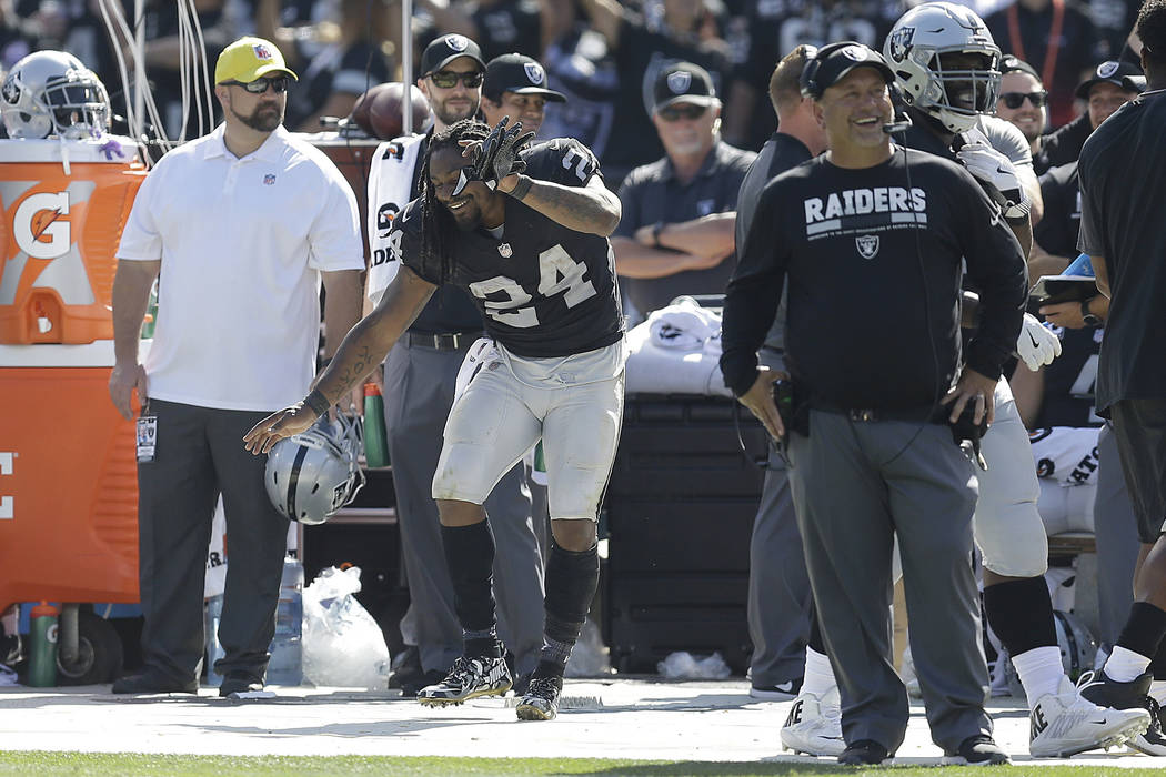 Oakland Raiders running back Marshawn Lynch (24) dances on the sideline during the second half of an NFL football game against the New York Jets in Oakland, Calif., Sunday, Sept. 17, 2017. (AP Pho ...