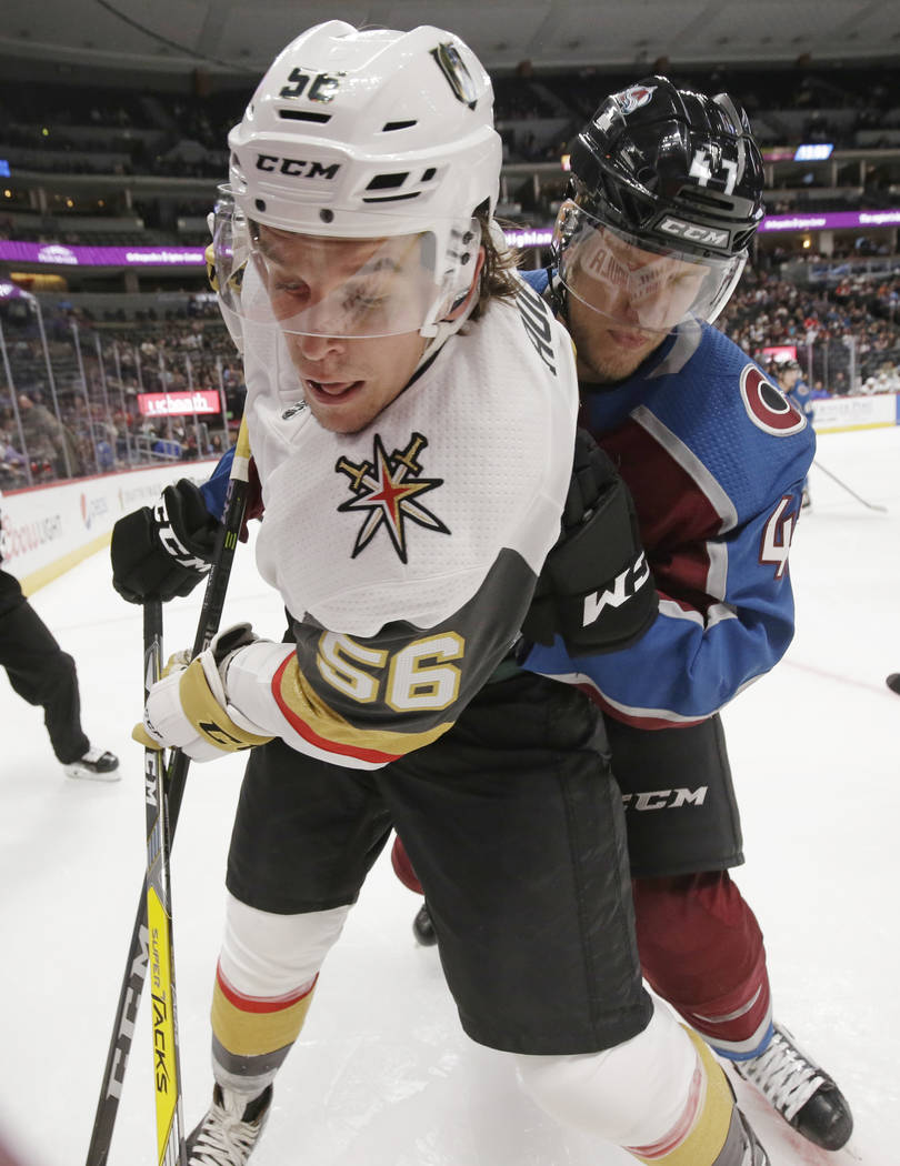 Colorado Avalanche center Dominic Toninato (47) checks Las Vegas Golden Knights left wing Erik Haula (56) into the boards during the second period of a preseason NHL hockey game Tuesday, Sept. 19, ...