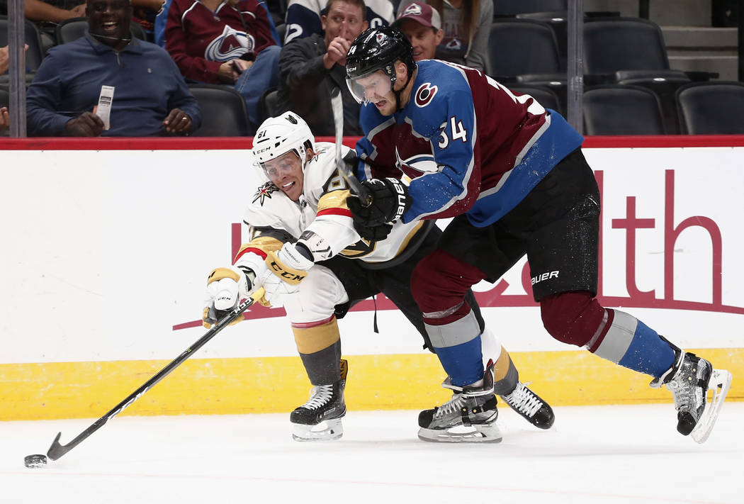 Las Vegas Golden Knights center Jonathan Marchessault (81) steals the puck from Colorado Avalanche center Carl Soderberg (34) during the second period of a preseason hockey game Tuesday, Sept. 19, ...
