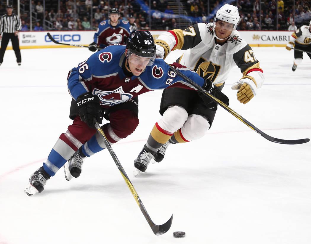 Colorado Avalanche right wing Mikko Rantanen (96) skates past Las Vegas Golden Knights defenseman Luca Sbisa (47) during the third period of a preseason hockey game, Tuesday, Sept. 19, 2017, in De ...