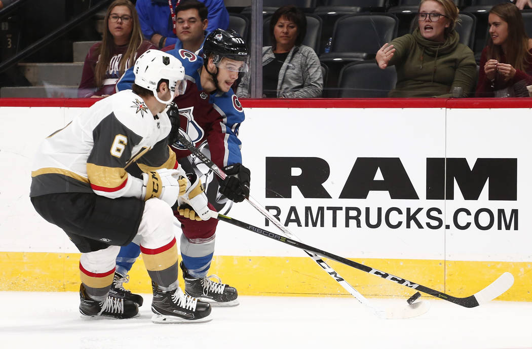 Colorado Avalanche center Alexander Kerfoot moves the puck against Las Vegas Golden Knights defenseman Colin Miller (6) during the third period of a preseason hockey game, Tuesday, Sept. 19, 2017, ...