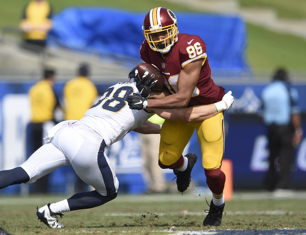 Washington Redskins tight end Jordan Reed (86) in action defended by Los Angeles Rams safety Cody Davis (38) during the second half of an NFL football game Sunday, Sept. 17, 2017, in Los Angeles.  ...