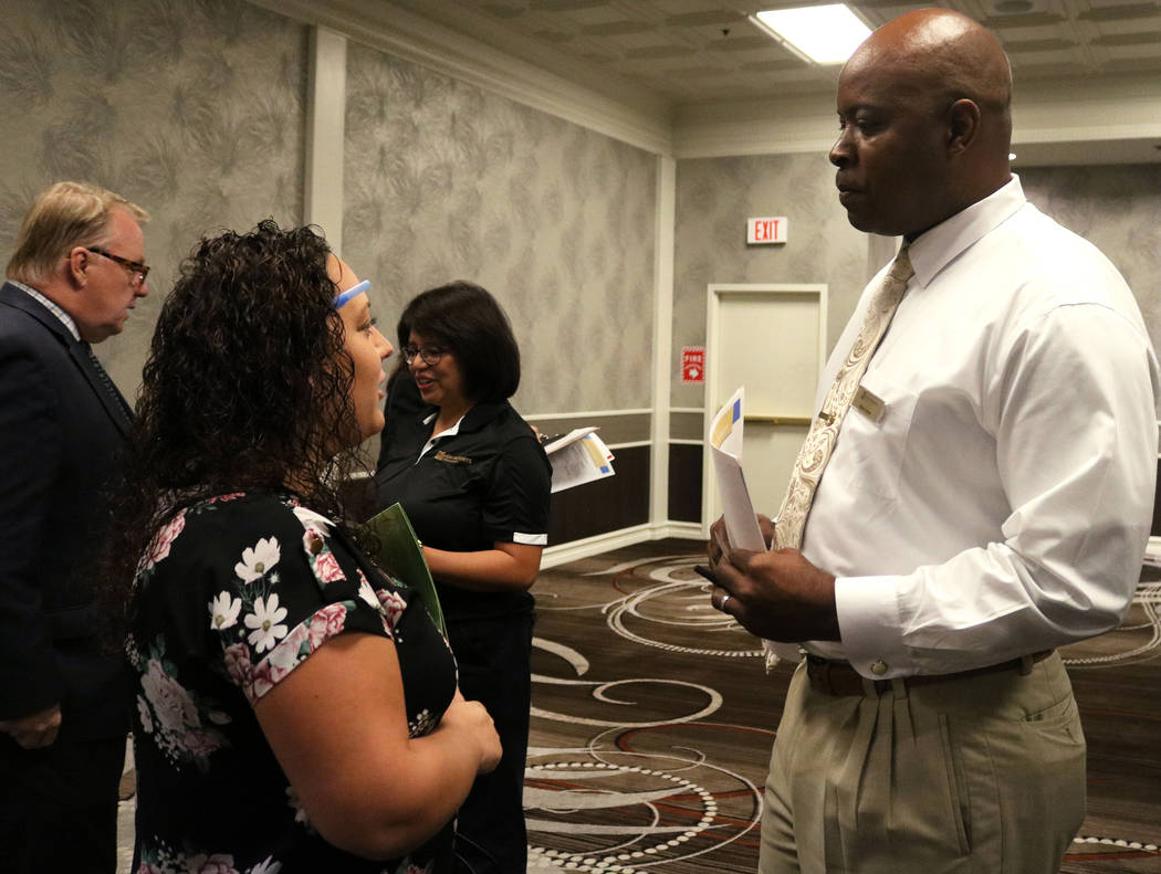 Rachel Paletz, left, speaks to Myron Carter, a recruiter from MGM Resorts International at Palace Station hotel-casino during the Las Vegas Review-Journal's job fair, Wednesday, Sept. 20, 2017. Ga ...