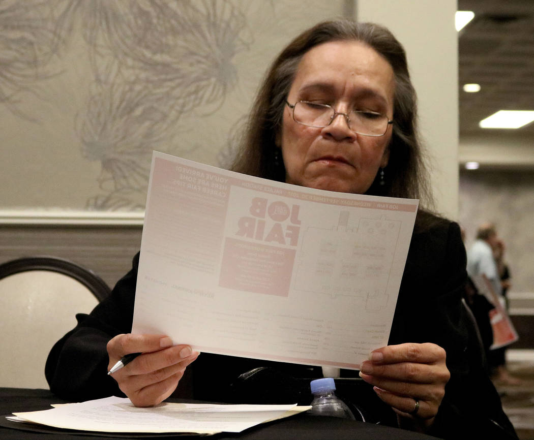 Job seeker Debbie Emdima looks over a map of the different booths at Palace Station hotel-casino during the Las Vegas Review-Journal's job fair, Wednesday, Sept. 20, 2017. Gabriella Benavidez Las  ...
