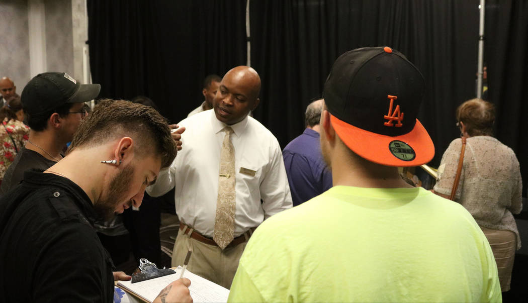 Myron Carter, a recruiter from MGM Resorts International, speaks to a group of job seekers at Palace Station hotel-casino during the Las Vegas Review-Journal's job fair, Wednesday, Sept. 20, 2017. ...