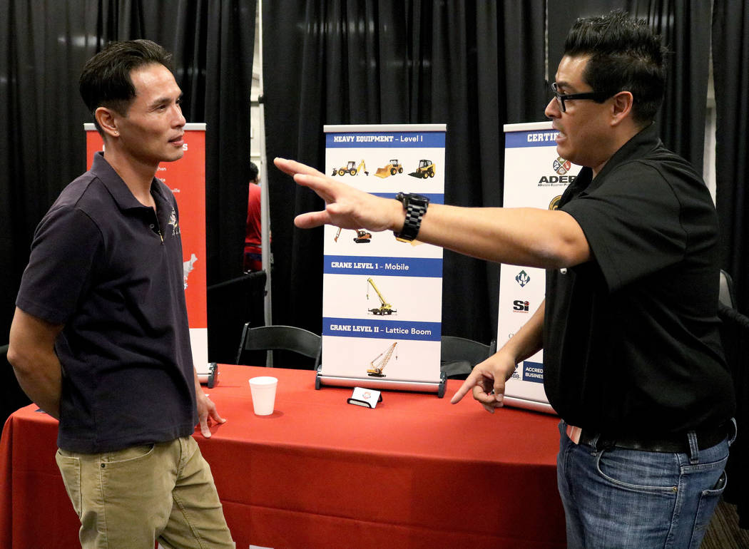 Jimmy Tran, left, speaks to Brandon Cosio  from Heavy Equipment Colleges of America at Palace Station hotel-casino during the Las Vegas Review-Journal's job fair, Wednesday, Sept. 20, 2017. Gabrie ...