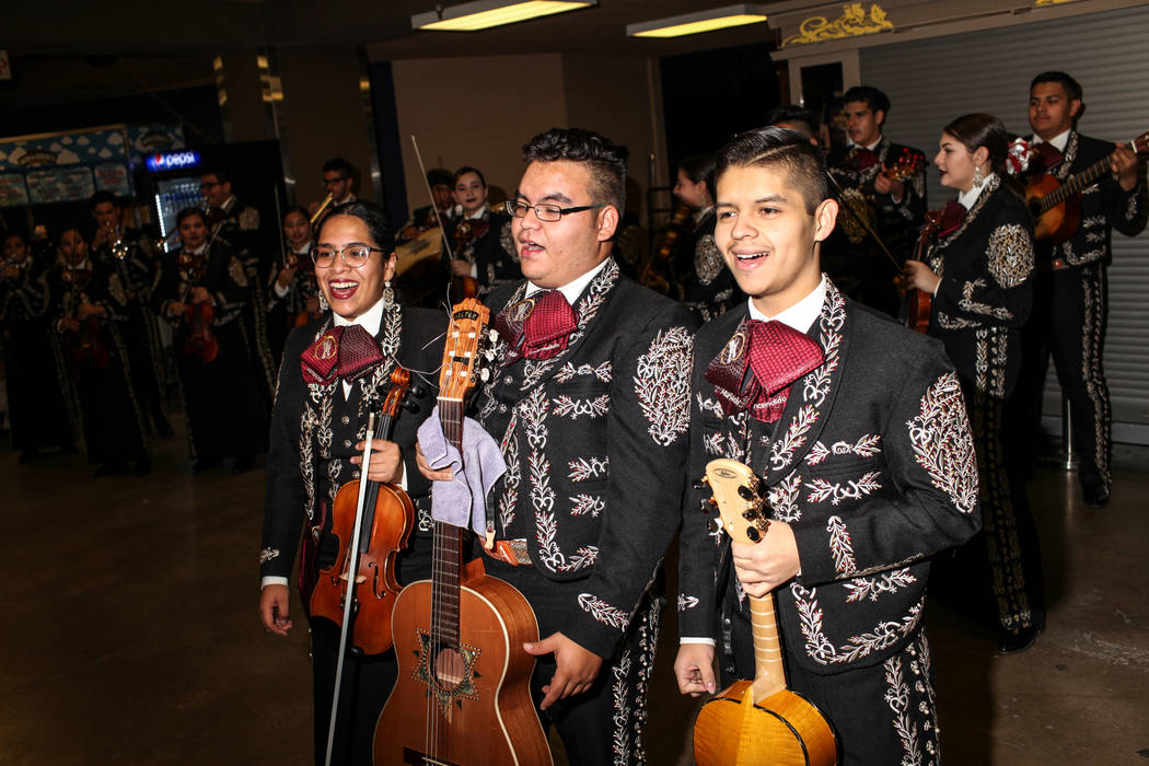 Emily Vargas, left, Victor Vargas-Perez, middle, and Antonio Rodriguez, right, sing mariachi during a baseball game between the Naranjeros de Hermosillo and Aguilas de Mexicali at the Cashman Fiel ...