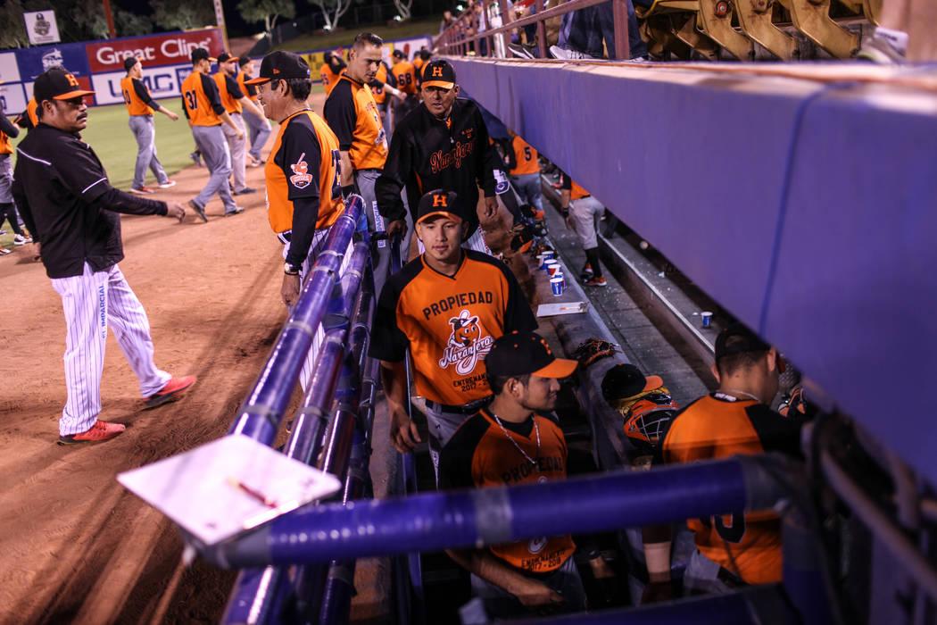 The Naranjeros de Hermosillo return to their dugout during a baseball game against the Aguilas de Mexicali at the Cashman Field in Las Vegas, Friday, Sept. 22, 2017. Joel Angel Juarez Las Vegas Re ...