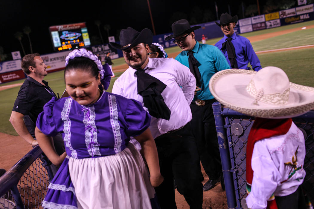 Dora Aburto, left, and Juan Aburto, right, return to the stands after a dance performance during a baseball game between the Naranjeros de Hermosillo and Aguilas de Mexicali at the Cashman Field i ...