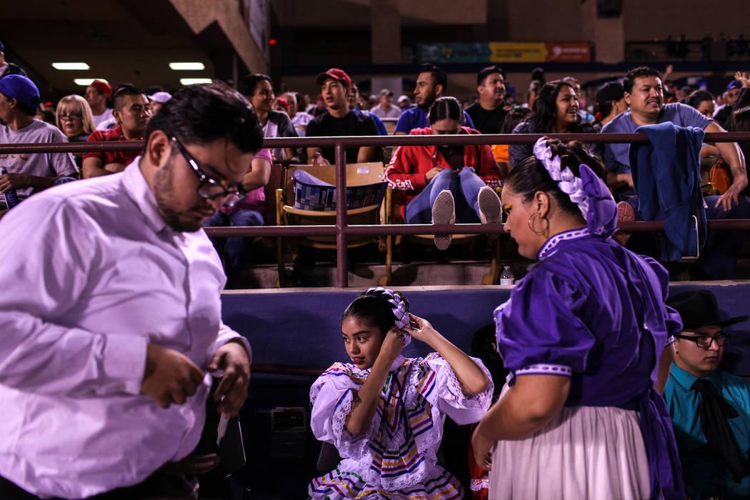 Damilet Almaraz, center, fixes her hair after a dance performance during a baseball game between the Naranjeros de Hermosillo and Aguilas de Mexicali at the Cashman Field in Las Vegas, Friday, Sep ...