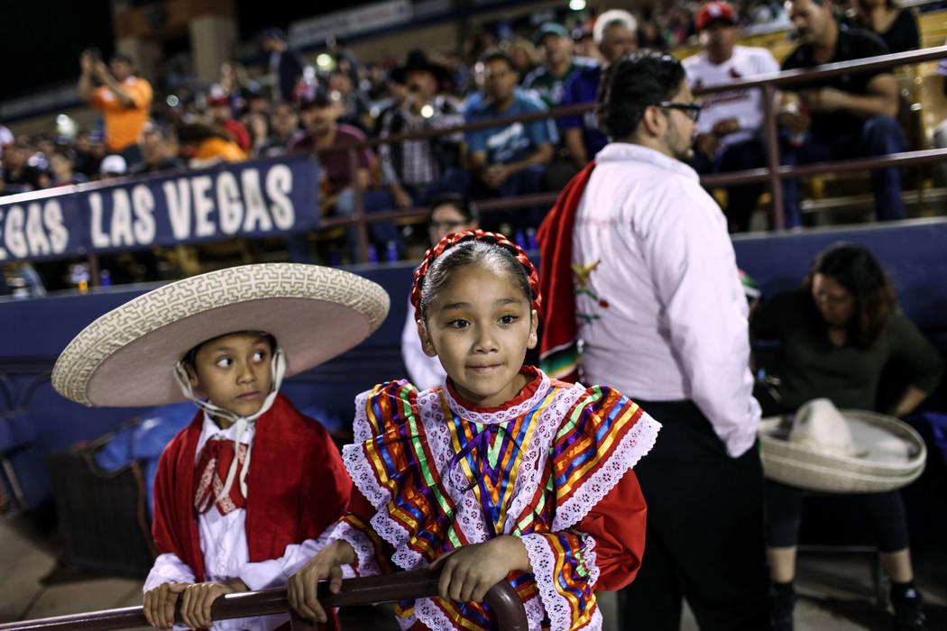 Sebastian Medina, 9, left, and Dariana Almaraz, 9, right, watch a baseball game between the Naranjeros de Hermosillo and Aguilas de Mexicali at the Cashman Field in Las Vegas, Friday, Sept. 22, 20 ...
