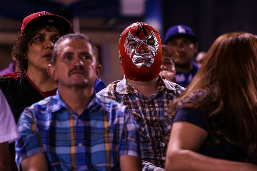 Tony Aviles, right, watches a baseball game between the Naranjeros de Hermosillo and Aguilas de Mexicali at the Cashman Field in Las Vegas, Friday, Sept. 22, 2017. Joel Angel Juarez Las Vegas Revi ...