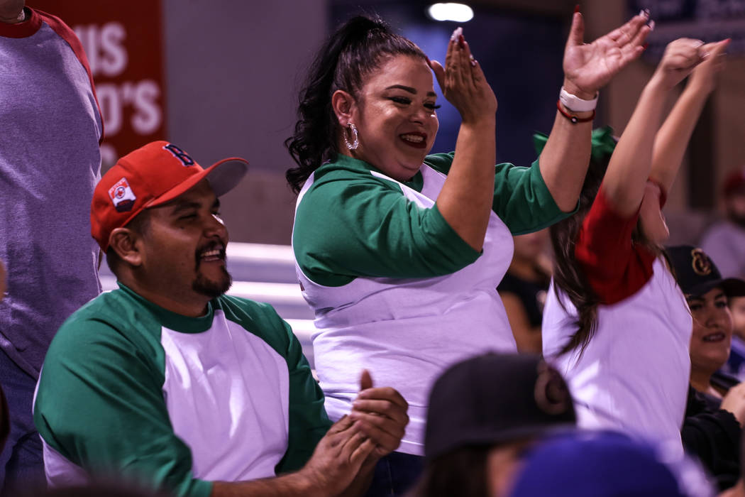 Evelyn Meza stands as she celebrates during a baseball game between the Naranjeros de Hermosillo and Aguilas de Mexicali at the Cashman Field in Las Vegas, Friday, Sept. 22, 2017. Joel Angel Juare ...