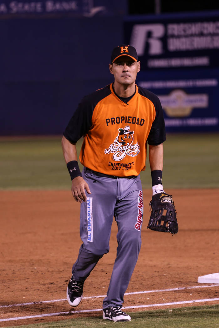 Naranjeros de Hermosillo's Luis Alfonso Garcia (18) returns to dugout at the end of an inning during a baseball game against the Aguilas de Mexicali at the Cashman Field in Las Vegas, Friday, Sept ...