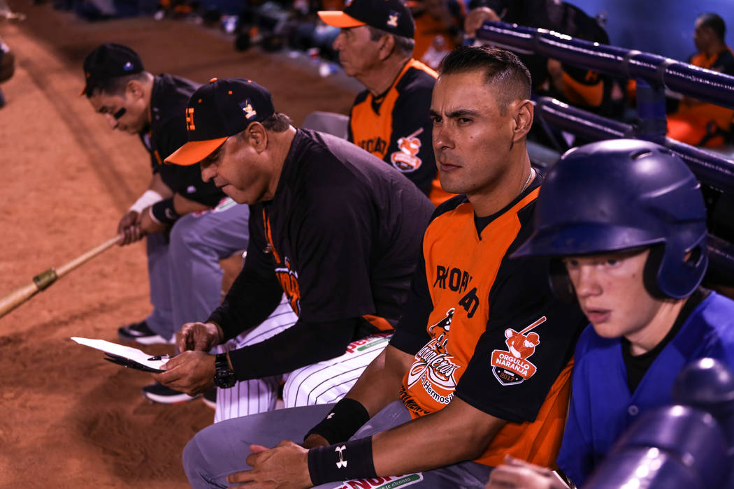 Naranjeros de Hermosillo's Luis Alfonso Garcia (18), second to the right, sits during a baseball game against the Aguilas de Mexicali at the Cashman Field in Las Vegas, Friday, Sept. 22, 2017. Joe ...
