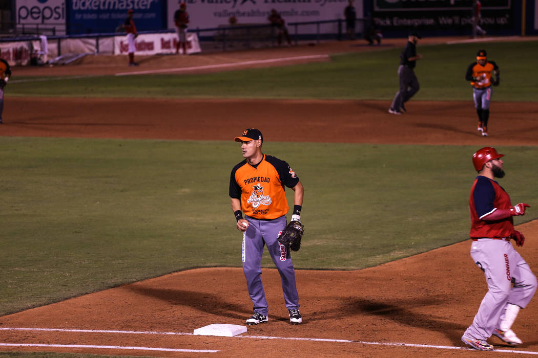 Naranjeros de Hermosillo's Luis Alfonso Garcia (18) guards first base during a baseball game against the Aguilas de Mexicali at the Cashman Field in Las Vegas, Friday, Sept. 22, 2017. Joel Angel J ...