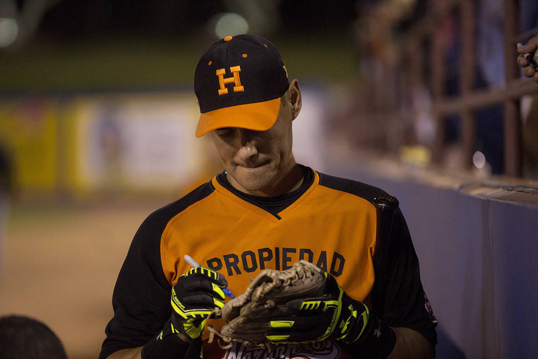 Hermosillo's Luis Garcia signs a baseball mitt prior to the start of the game against Mexicali at Cashman Field on Saturday, Sept. 23, 2017, in Las Vegas.  Bridget Bennett Las Vegas Review-Journal ...