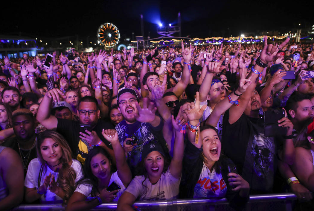 Attendees react as Cage the Elephant performs at the Downtown stage during the second day of the Life is Beautiful festival in downtown Las Vegas on Saturday, Sept. 23, 2017. Chase Stevens Las Veg ...