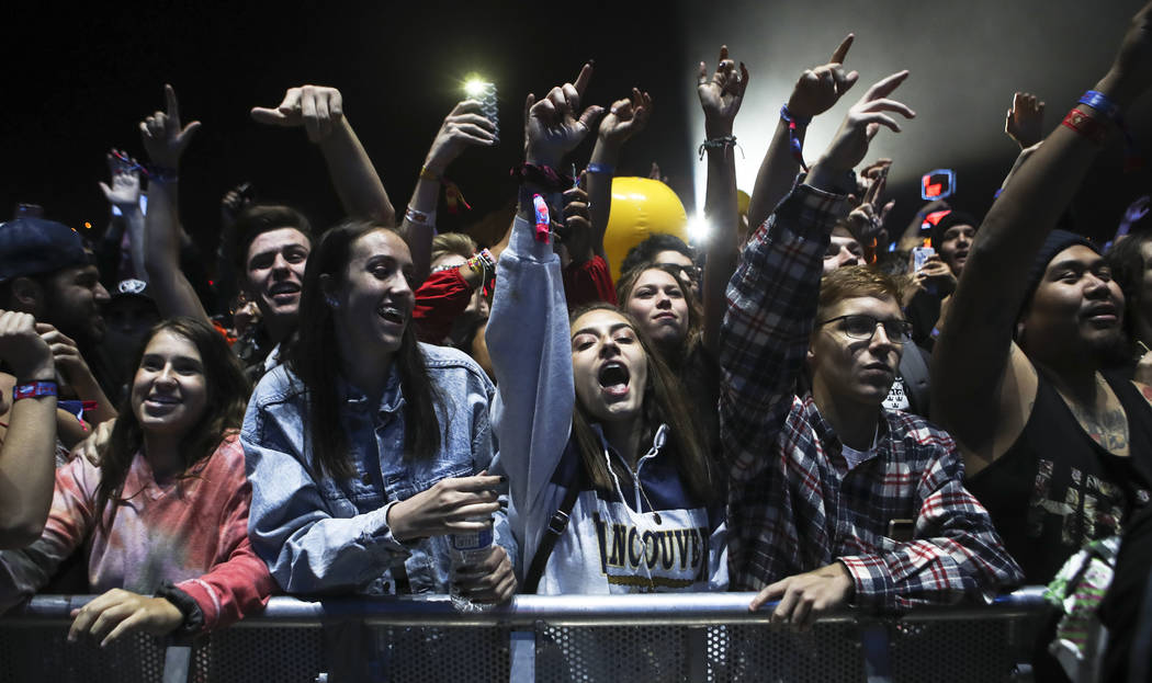 Attendees react as Wiz Khalifa performs at the Ambassador stage during the second day of the Life is Beautiful festival in downtown Las Vegas on Saturday, Sept. 23, 2017. Chase Stevens Las Vegas R ...