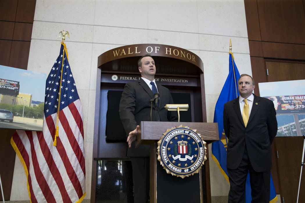 Adam Barthelmess, left, president of Clear Channel Outdoor in Las Vegas, and Aaron C. Rouse, special agent in charge for the FBI in Nevada, during a press conference announcing the FBI's joint par ...