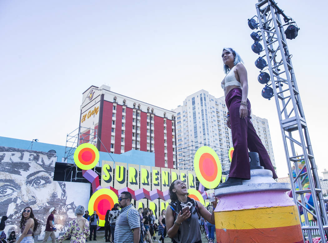 Shayla Raya, right, stands on a pilar outside the Meow Wolf Art Motel during the final day of the Life is Beautiful music and arts festival on Sunday, September 24, 2017, in Las Vegas. Benjamin Ha ...