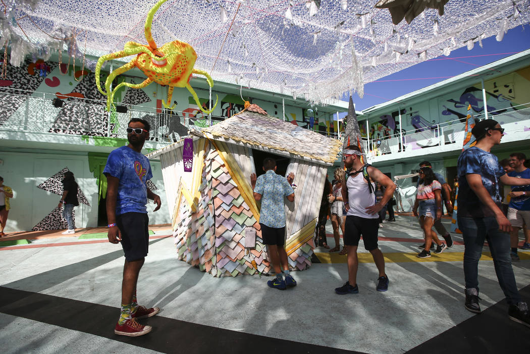 Attendees explore the Art Motel by Meow Wolf during the final day of the Life is Beautiful festival in downtown Las Vegas on Sunday, Sept. 24, 2017. Chase Stevens Las Vegas Review-Journal @cssteve ...