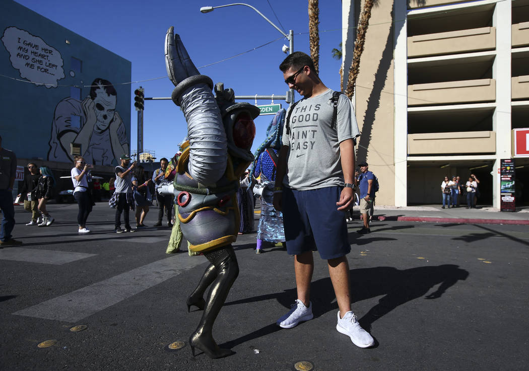 A member of performance art group Big Nazo interacts with Hayden Engell of Las Vegas during the final day of the Life is Beautiful festival in downtown Las Vegas on Sunday, Sept. 24, 2017. Chase S ...