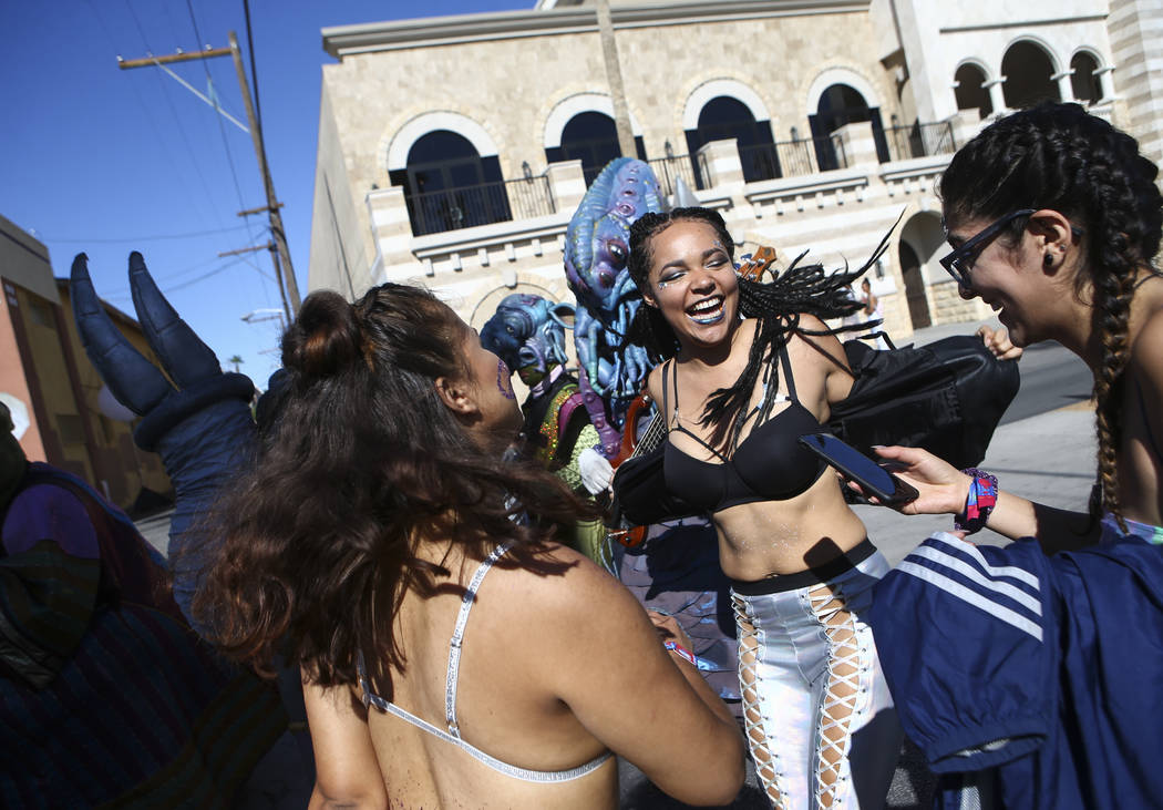 Attendees dance during a performance by art group Big Nazo during the final day of the Life is Beautiful festival in downtown Las Vegas on Sunday, Sept. 24, 2017. Chase Stevens Las Vegas Review-Jo ...