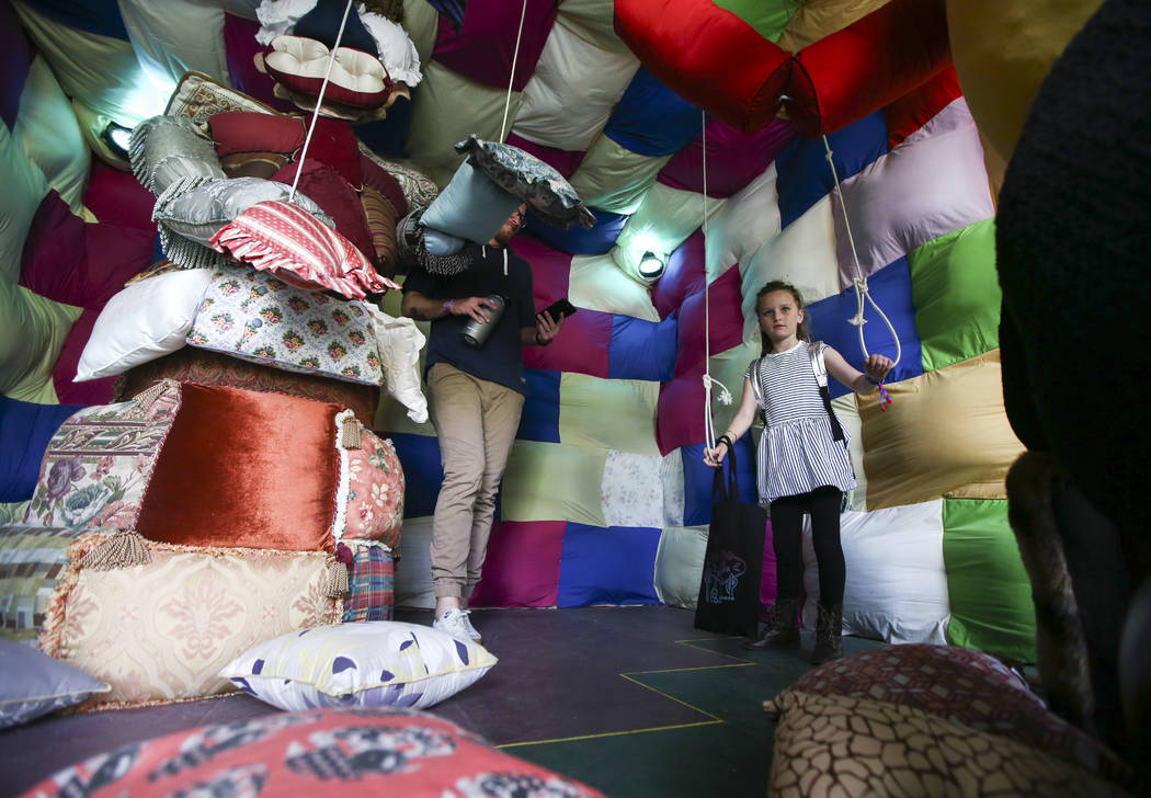 Reese, 6, operates a large-scale puppet at the Art Motel by Meow Wolf during the final day of the Life is Beautiful festival in downtown Las Vegas on Sunday, Sept. 24, 2017. Chase Stevens Las Vega ...