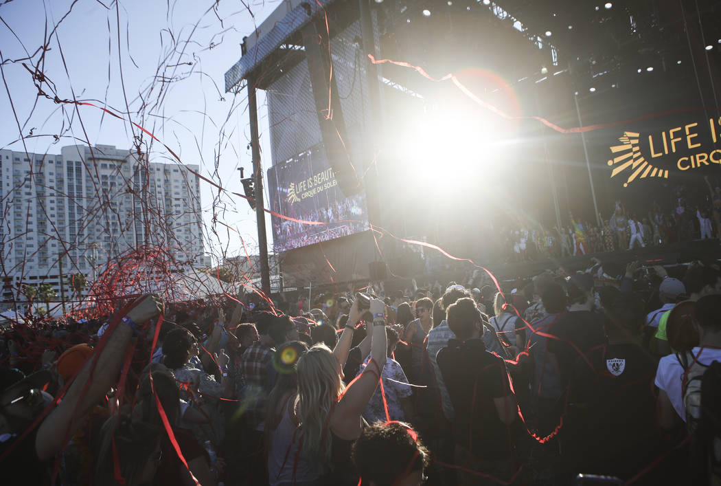 Confetti flies in the air at the end of a performance from Cirque du Soleil at the Downtown stage during the final day of the Life is Beautiful festival in downtown Las Vegas on Sunday, Sept. 24,  ...