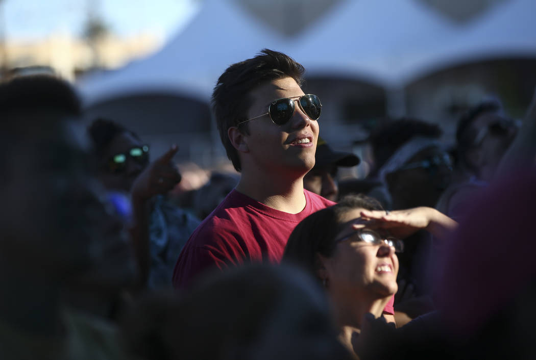 Attendees wait for Cirque du Soleil at the Downtown stage during the final day of the Life is Beautiful festival in downtown Las Vegas on Sunday, Sept. 24, 2017. Chase Stevens Las Vegas Review-Jou ...