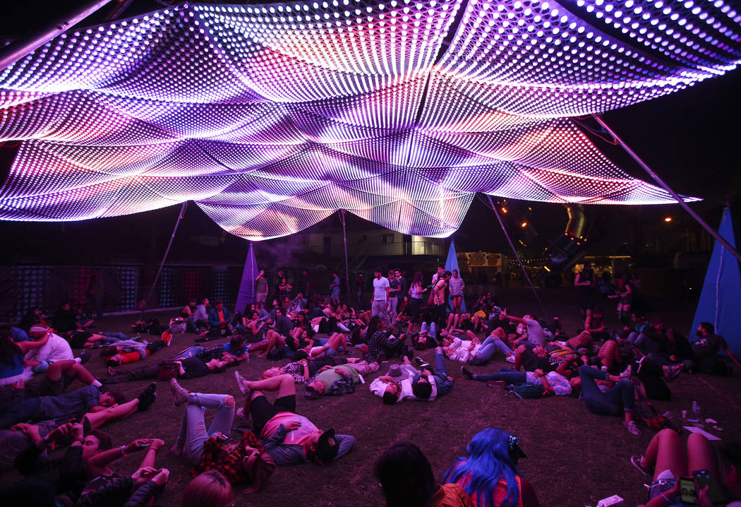 Attendees relax under a light display during the final day of the Life is Beautiful festival in downtown Las Vegas on Sunday, Sept. 24, 2017. Chase Stevens Las Vegas Review-Journal @csstevensphoto