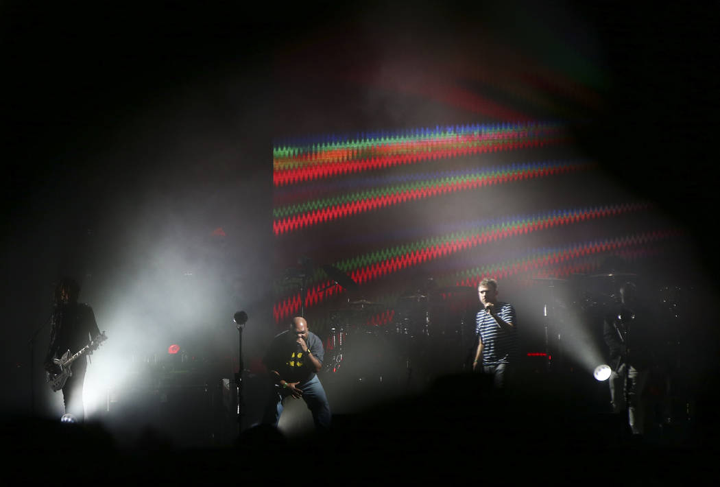 DJ Maseo of De La Soul, center left, joins Damon Albarn of Gorillaz at the Downtown stage during the final day of the Life is Beautiful festival in downtown Las Vegas on Monday, Sept. 25, 2017. Ch ...