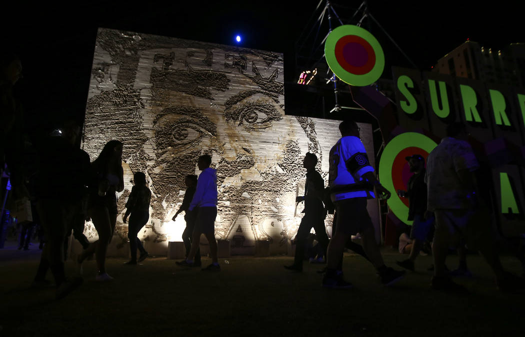 Attendees walk the festival grounds during the final day of the Life is Beautiful festival in downtown Las Vegas on Sunday, Sept. 24, 2017. Chase Stevens Las Vegas Review-Journal @csstevensphoto