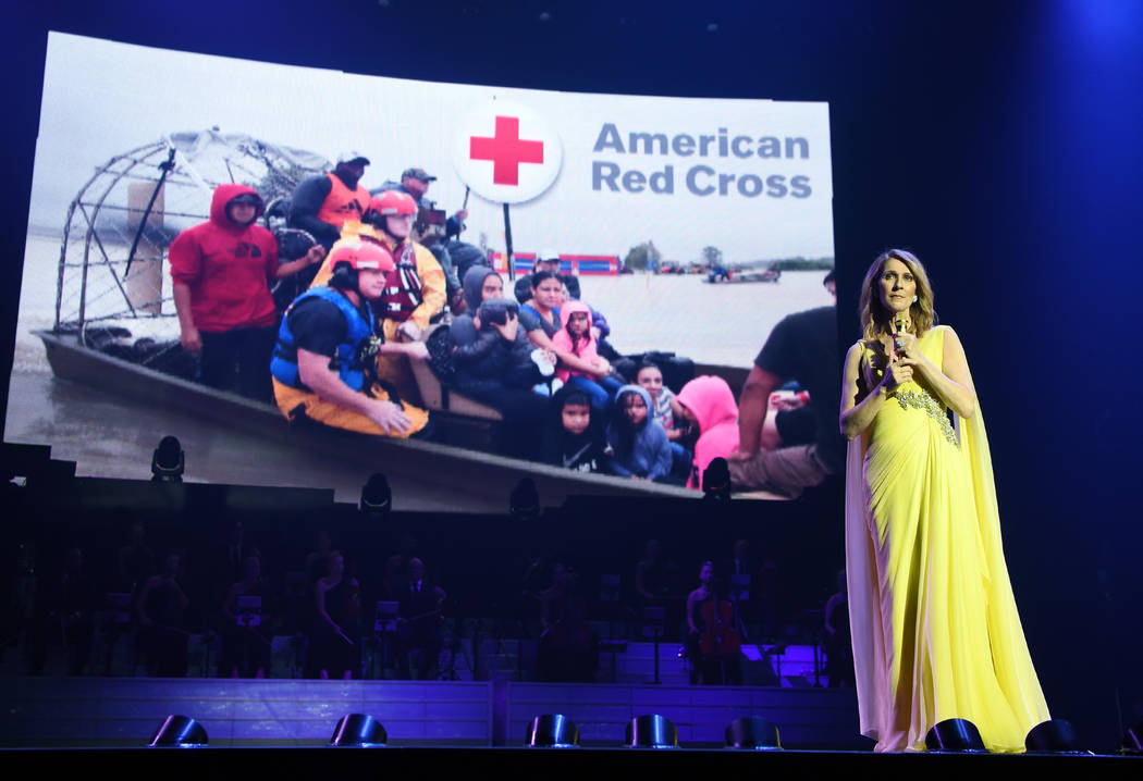 Celine Dion is shown announcing a donation-matching campaign with the American Red Cross for hurricane relief efforts in the southeast during her show at the Colosseum at Caesars Palace on Tuesday ...