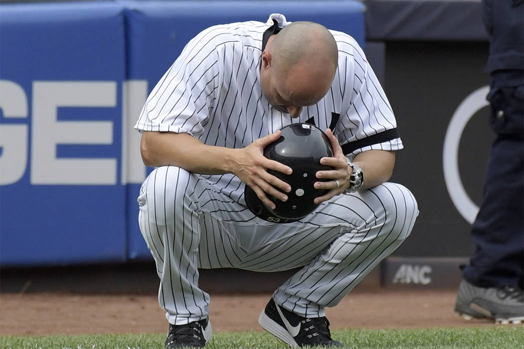 New York Yankees third base coach Joe Espada reacts after a young girl was hit by a line drive during the fifth inning of a baseball game against the Minnesota Twins Wednesday, Sept. 20, 2017, at  ...