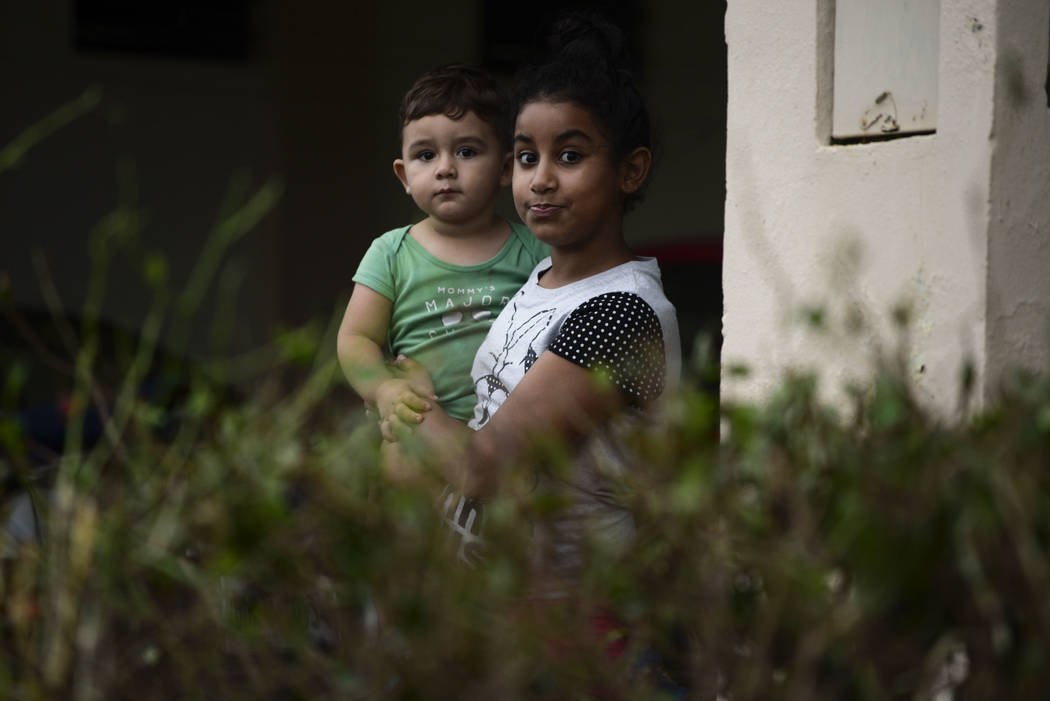 A boy and a girl stare at the camera from their house after Hurrciane Maria hit the eastern region of the island, in Humacao, Puerto Rico, Wednesday, Sept. 20, 2017. The strongest hurricane to hit ...