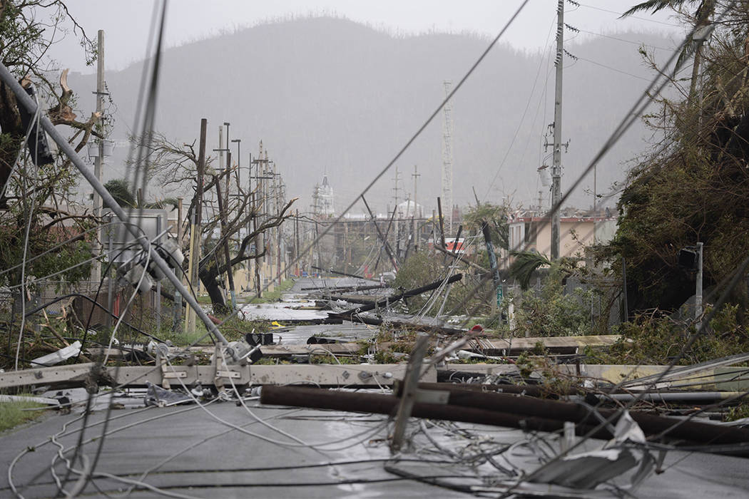 Electricity poles and lines lay toppled on the road after Hurricane Maria hit the eastern region of the island, in Humacao, Puerto Rico, Wednesday, Sept. 20, 2017. The strongest hurricane to hit P ...