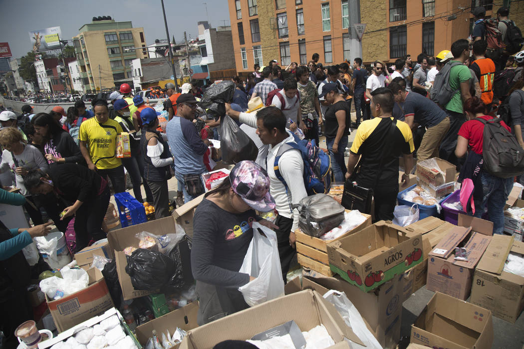 Volunteers prepare food and water for emergency personnel searching for survivors in Mexico City, Mexico, Wednesday, Sept. 20, 2017. A 7.1 magnitude earthquake struck southern Mexico dealing a dev ...