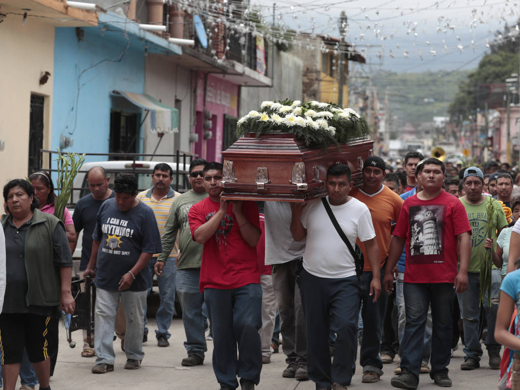 Locals carry the casket of a woman who died in Tuesday's earthquake, in Tlayacapan, Morelos state, Mexico, Wednesday, Sept. 20, 2017. (Eduardo Verdugo/AP)