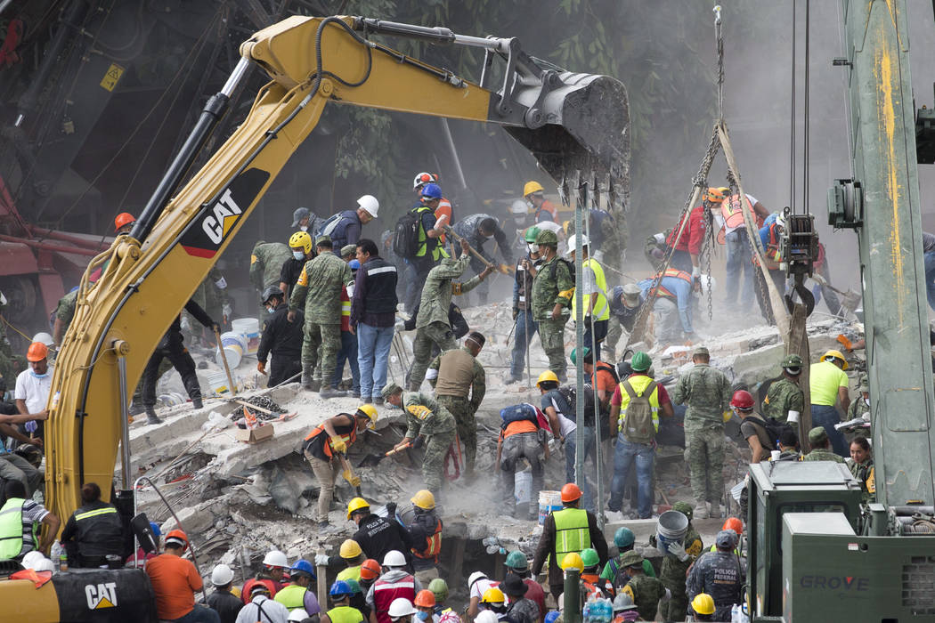 Rescue personnel work on a collapsed building, a day after a devastating 7.1 earthquake in the Del Valle neighborhood of Mexico City, Wednesday, Sept. 20, 2107. (Moises Castillo/AP)